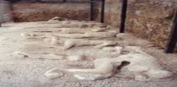 """Garden of the Fugitives"". Some plaster casts of victims of the eruption still in actual Pompeii; many are in the Archaeological Museum of Naples."