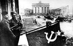 Berlin after the war Russian flag held by the soviets out of a hotel balcony.