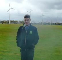 This is Brian standing on the pitch with the 5 wind turbines behind him.